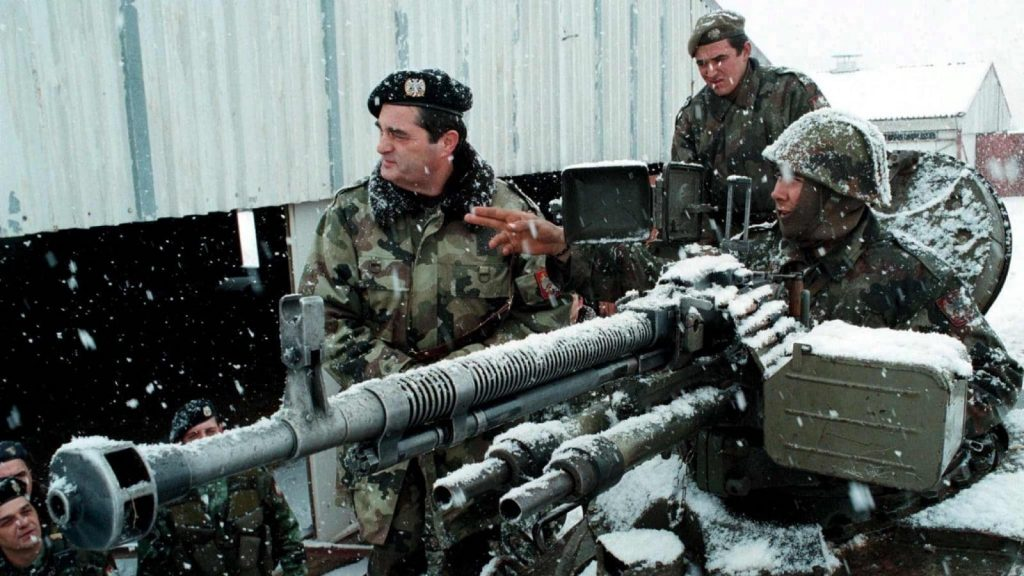 Yugoslav Army commander Nebojsa Pavkovic (left) listens to a soldier's report near Gjilan/Gnjilane in Kosovo during the war in February 1999. (Photo: EPA/File)
