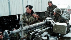 Yugoslav Army commander Nebojsa Pavkovic (left) listens to a soldier's report near Gjilan/Gnjilane in Kosovo during the war in February 1999. (Photo: EPA/File)