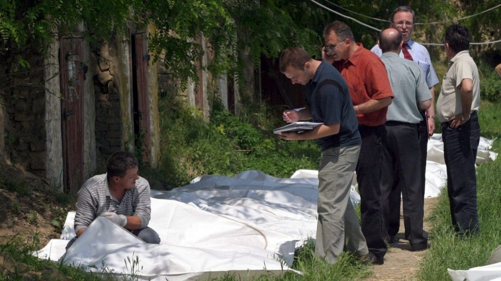 Serbian and UN investigators with body bags containing the remains of ethnic Albanians ready for return to Kosovo in May 2005, after they were exhumed from a police training centre in Batajnica in Serbia. Photo: EPA/Saša Stanković
